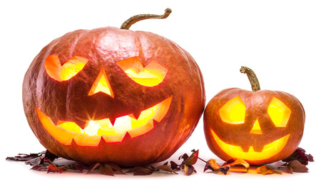 Grinning pumpkin lantern or jack-o-lantern is one of the symbols of Halloween. Halloween attribute. Stock Photo