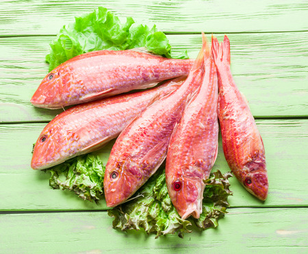 goatfish: Red mullets on the wooden board.