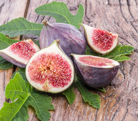 purple fig: Ripe fig fruits on the wooden table.