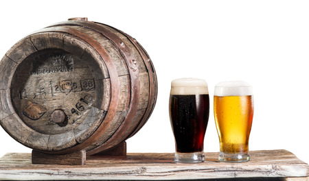 microbrewery: Glasses of  beer and ale barrel on the wooden table. Craft brewery. Clipping paths.