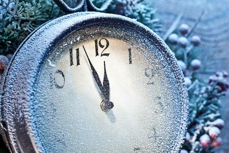 twelve: Five minutes to twelve. Snowy Christmas clocks.