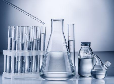 scientific research: Different laboratory beakers and glassware. Monochrome. Stock Photo