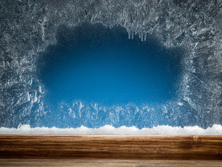window frame: Wooden sill and frozen window. Christmas or New Year background. Stock Photo