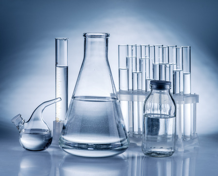 discovery: Different laboratory beakers and glassware. Monochrome. Stock Photo
