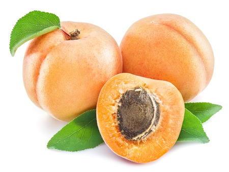 Apricot fruits and its cross-section on the white background. Stock Photo