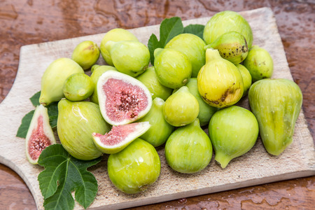 Ripe fig fruits on the wooden table.