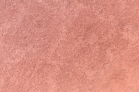 surface level: Red stucco surface. Close up picture of wall.