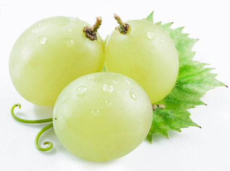 white washed: Three grapes with small leaf on the white background. Stock Photo