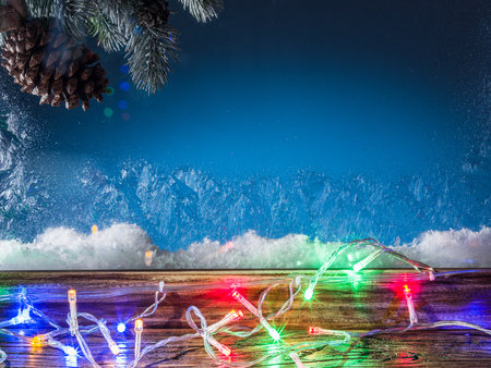 Christmas lights and frozen window. Christmas background.