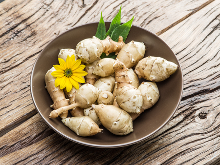 jerusalem artichoke: Jerusalem artichoke on wooden table. Stock Photo