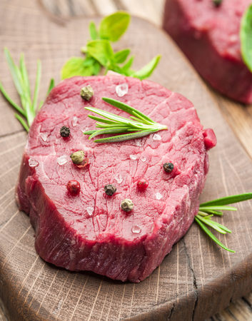 Piece of beef tenderloin on the wooden cutting board. Stock Photo