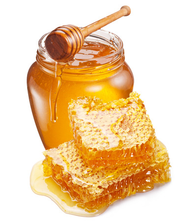 drizzler: Jar full of fresh honey and honeycombs isolated on white background.