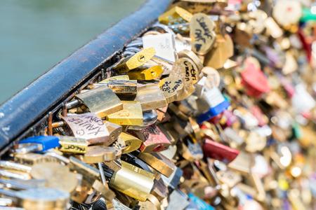 Lot of love padlocks on the bridge safety fence.