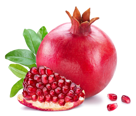 Ripe pomegranate fruits with pomegranate leaves on the white background. Stock Photo