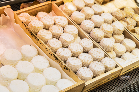 Different cheeses at open air-market. Stock Photo