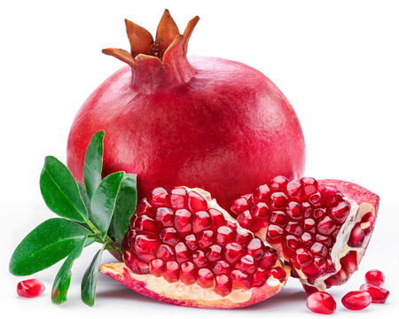 Ripe pomegranate fruits with pomegranate leaves on the white background. Stockfoto