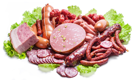 Variety of dry cured sausage products and meat. Foto de archivo