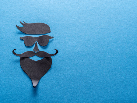 Hipsters definicial facial look cut from paper. Stock Photo