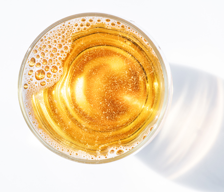 Glass of beer. Top view of lager beer or light beer on the white background.