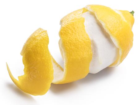 Peeled lemon and lemon zest on white background. Close-up.