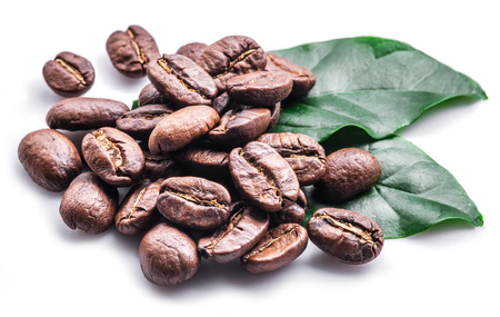 Roasted coffee beans and leaves on white background. Standard-Bild