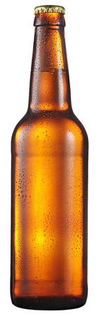 Cold bottle of beer with condensated water drops on it. File contains clipping path. Standard-Bild