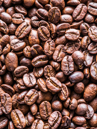 Roasted coffee beans. Top view.