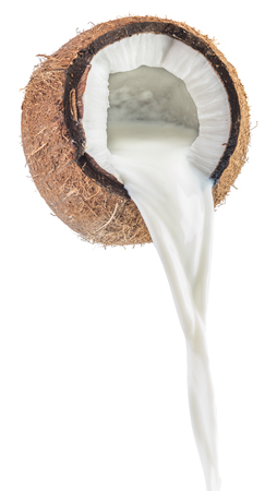 Coconut milk pouring out of coconut fruit.