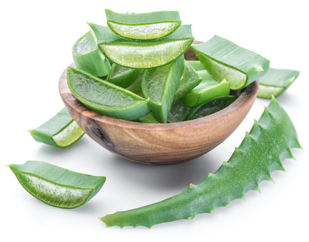 Fresh aloe vera slices in the wooden bowl on white background.