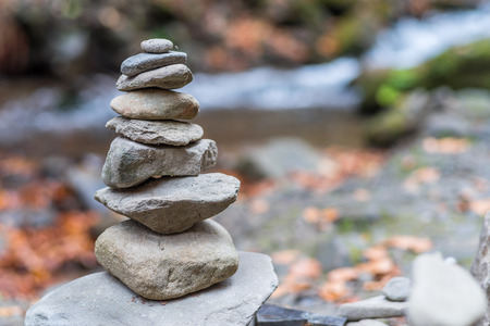 Balanced stones or stone pyramid on the river bank.