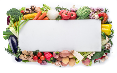 Different colorful vegetables arranged as a frame on white background. Stock Photo