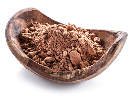 Cocоa powder or carob powder in wooden bowl on white background.
