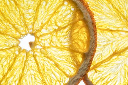 Dried orange fruit slices isolated on white background. Stock Photo