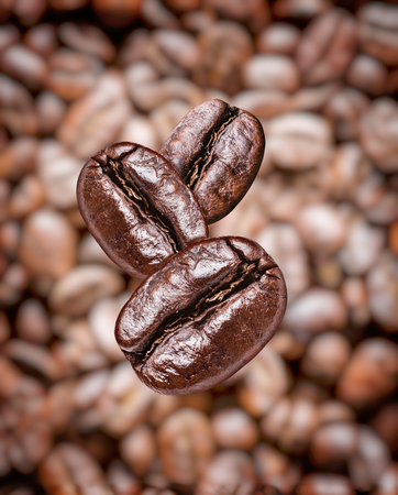Three roasted coffee beans close-up. Coffee beans background. Imagens