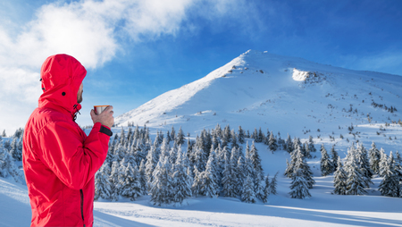 Winter hiking. Tourists are hiking in the snow-covered mountains. Beautiful winter landscape in the mountains. Stock Photo