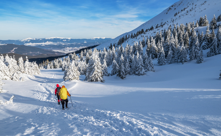 Winter hiking. Tourists are hiking in the snow-covered mountains. Beautiful winter landscape in the mountains. Stock fotó