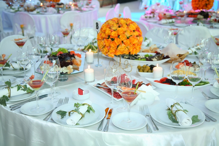 Holiday table setting decorated with flowers and candles.