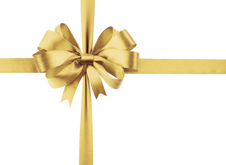 Golden sateen ribbon with bow as a gift symbol on white background. Фото со стока