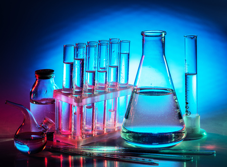 Different laboratory beakers and glassware. Multicolored.