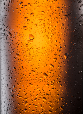Misted glass of beer bottle. Close up shot. Stock Photo