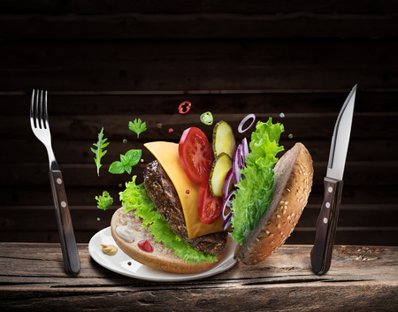 Hamburger ingredients falling down one by one to create a perfect meal. Stock fotó