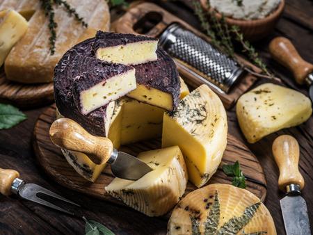 Homemade cheeses on the wooden Фото со стока