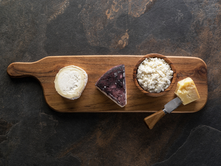 Cheese platter with different homemade organic cheeses on stone background. Top view. 写真素材 - 119385187