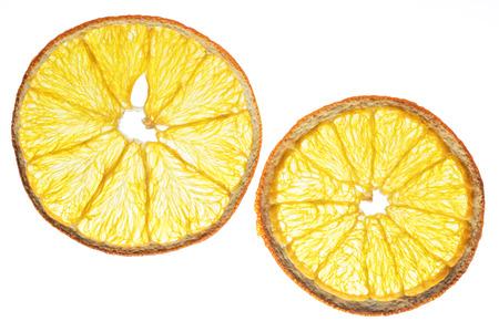 Dried orange fruit slices isolated on white background. Organic food.
