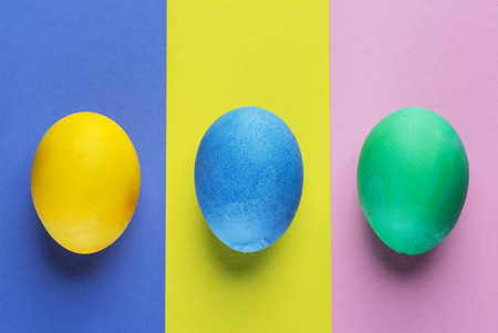 Stained Easter eggs as an attribute of Easter celebration on colorful background.
