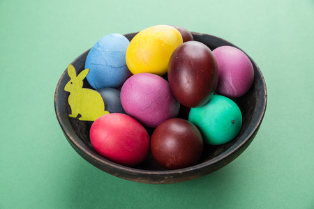 Colorful Easter eggs in bowl. Attribute of Easter celebration.