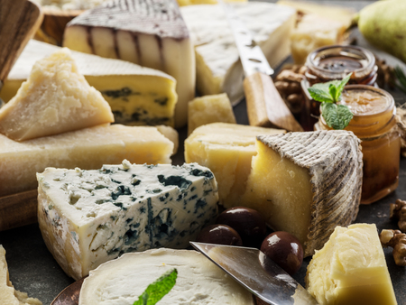 Assortment of different cheeses with olives and jams. Food background. 写真素材 - 119389678