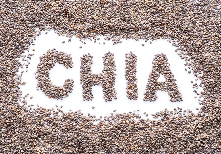 Chia word made up of chia seeds isolated on white background. Stock Photo