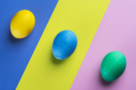 Stained Easter eggs as an attribute of Easter celebration on colorful