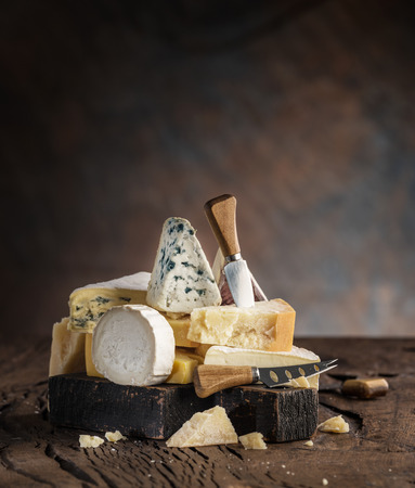 Assortment of different cheese types on wooden 写真素材 - 121245065